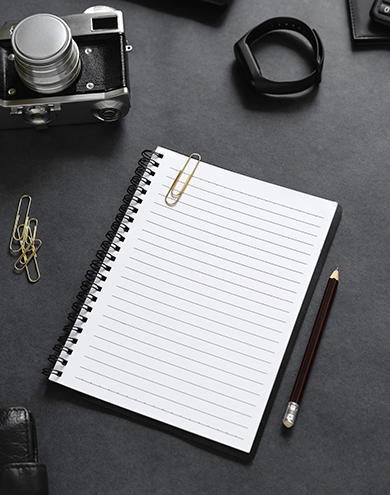 top-view-open-notebook-with-stationery-items.png